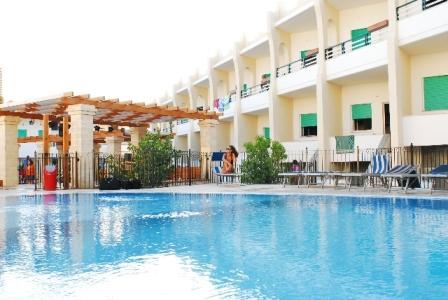 13_cala-saracena-club-resort-village_piscina.jpg