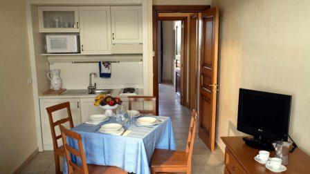 196_portoselvaggio-holiday-resort_14_soggiorno.jpg