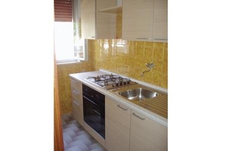 210_appartamenti-in-via-monti_angolo-cottura3.jpg