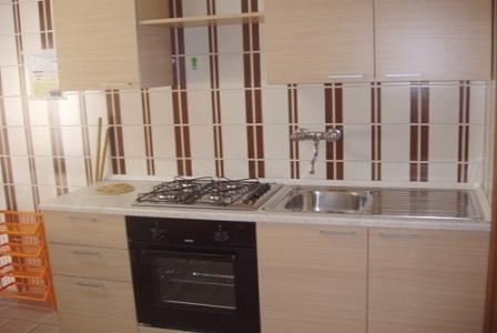210_appartamenti-in-via-monti_angolo-cucina.jpg