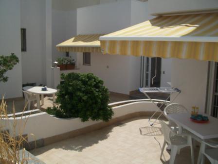 258_le-sorgenti-case-vacanza_appartamenti_le_sorgenti_veranda_attrezzata.jpg