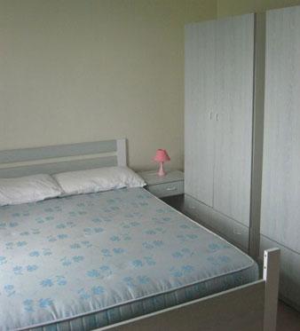 279_appartamenti-green--baia-verde_trilo_camera.jpg