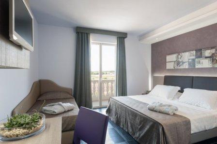 310_le-dune-suitel-hotel_ledunesuite_porto_cesareo_camera_tripla.jpg
