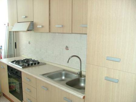 324_appartamenti-rivabella_appartamenti_rivabella_gallipoli_cucina.jpg