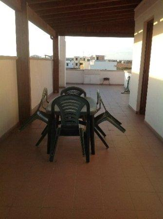 367_appartamento-elba-010_esterno-tettoia-mansarda.jpg