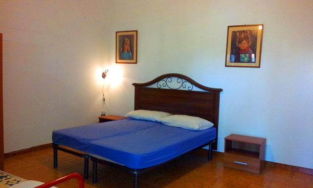438_appartamento-il-pino-torre-suda_camera-matrimoniale.jpg