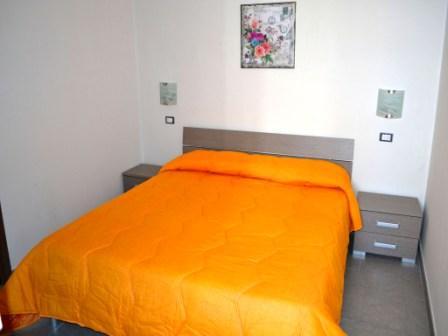 492_appartamenti-pascoli_camera-matrimoniale.jpg