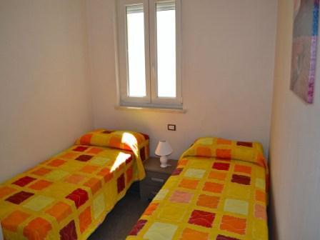 492_appartamenti-pascoli_cameretta.jpg