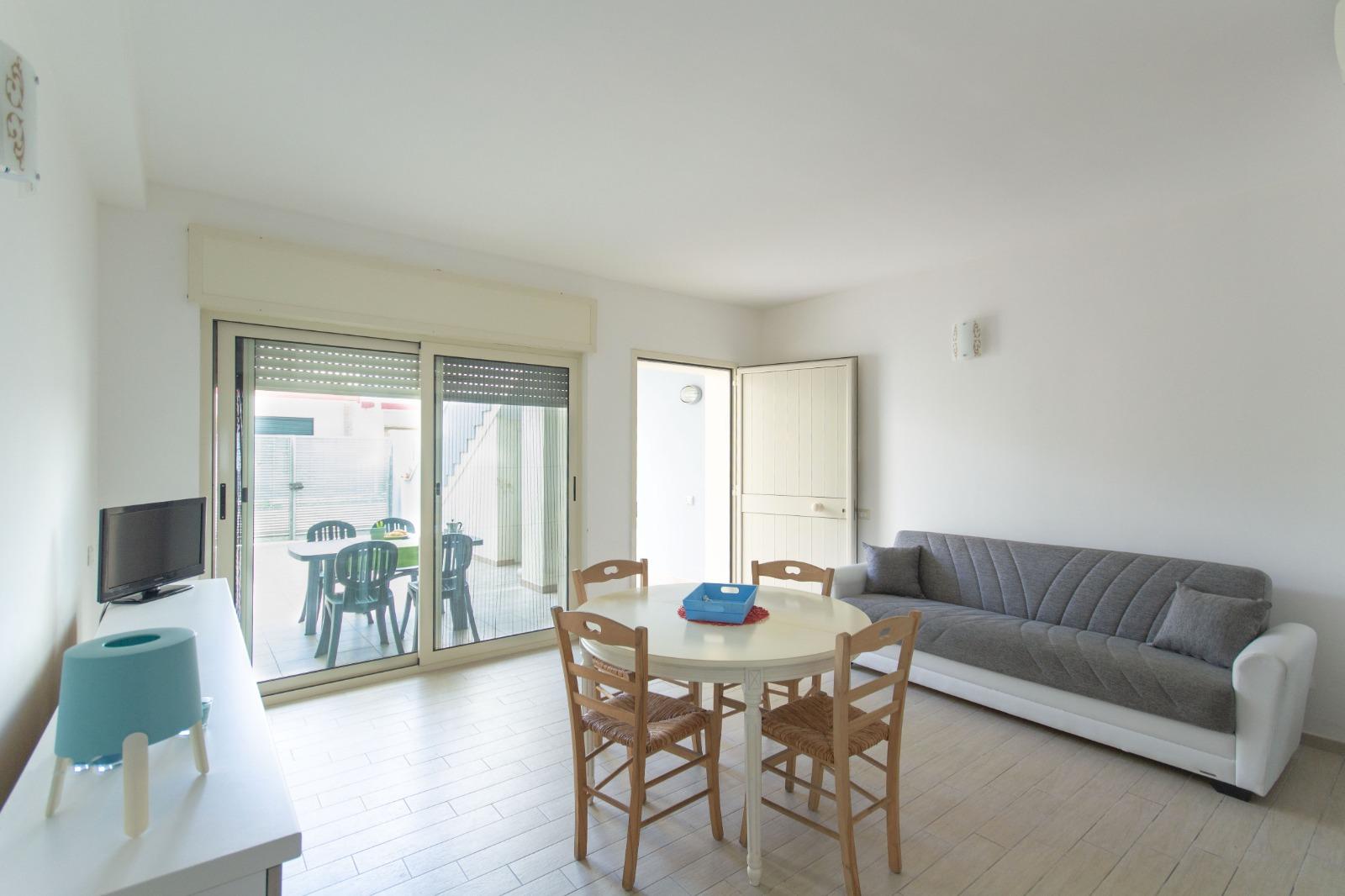 505_appartamento-volta_6._soggiorno_con_divano.jpg