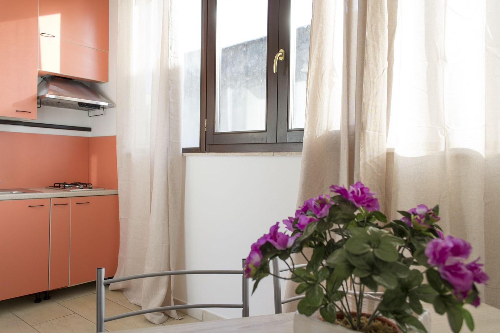 510_monolocale-la-cueva_angolo_cottura.jpg