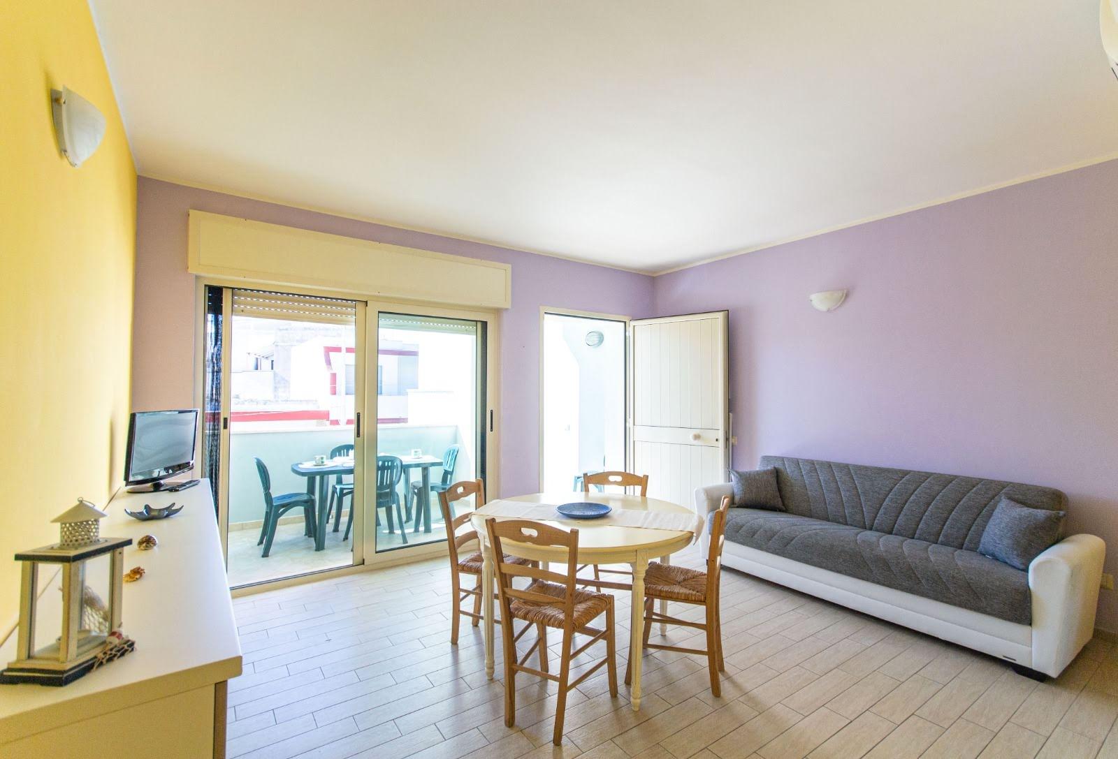 512_appartamento-volta-primo-piano_5._soggiorno_con_divano_letto.jpg