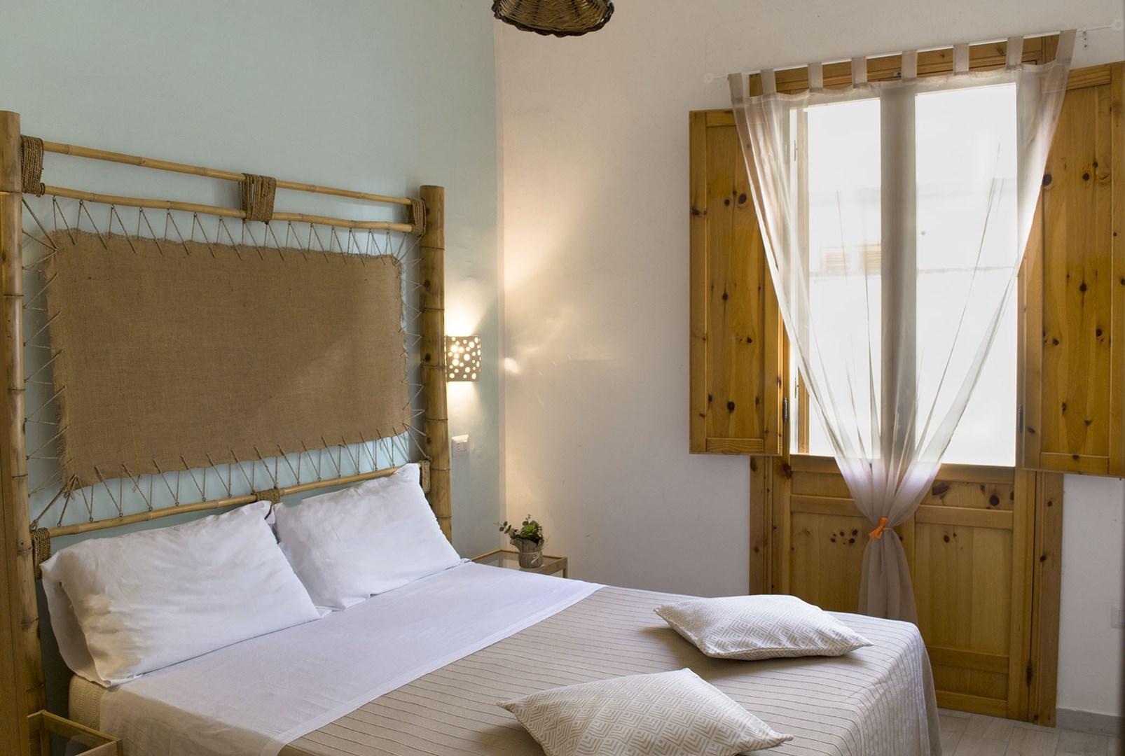 6_residence-borgo-latino_residence_borgo_latino_camera_matrimoniale_trilo.jpg