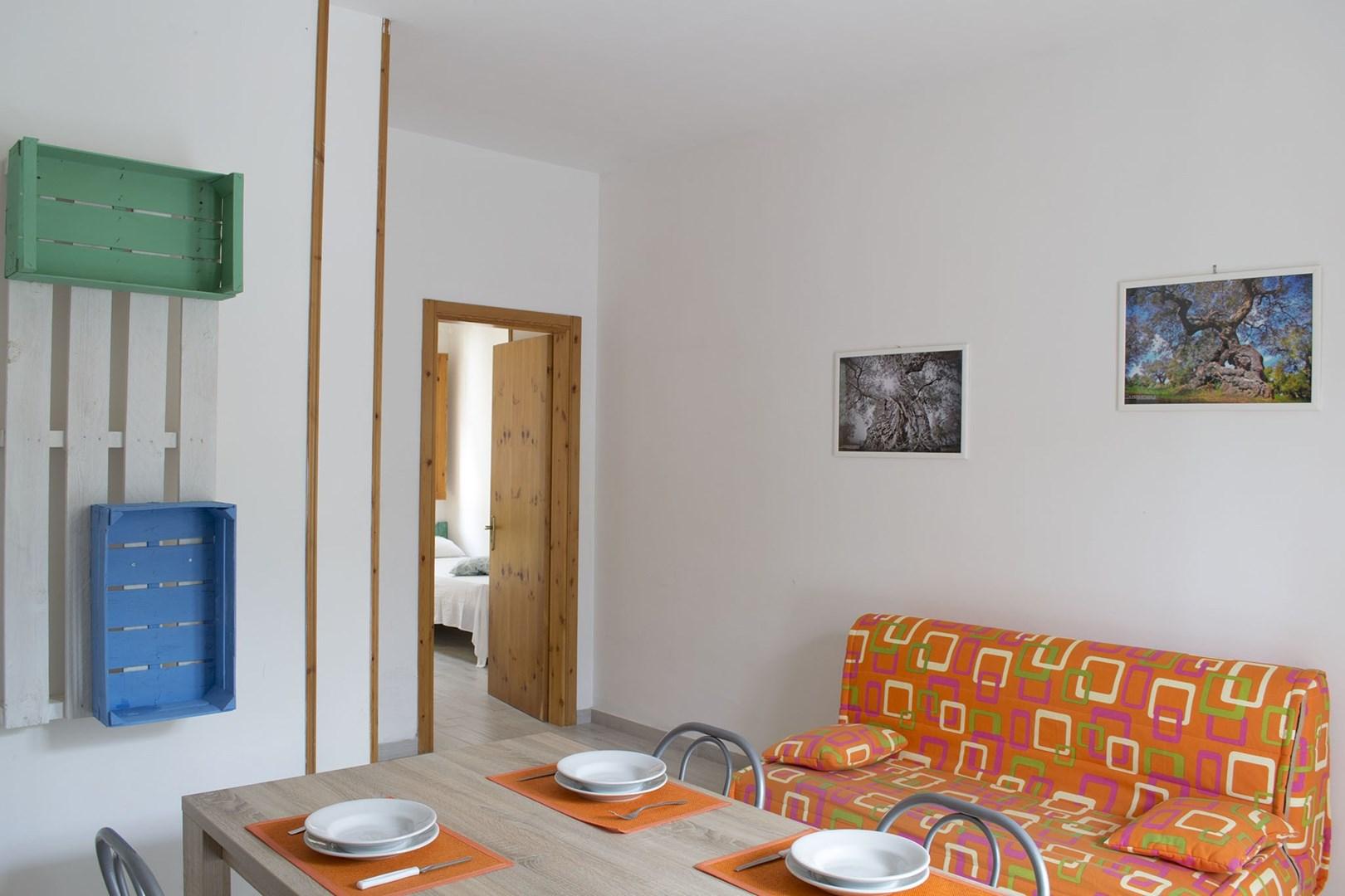 6_residence-borgo-latino_residence_borgo_latino_soggiorno_trilo_2.jpg