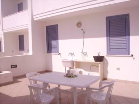 87_le-residenze-il-porticciolo_cortile.jpg